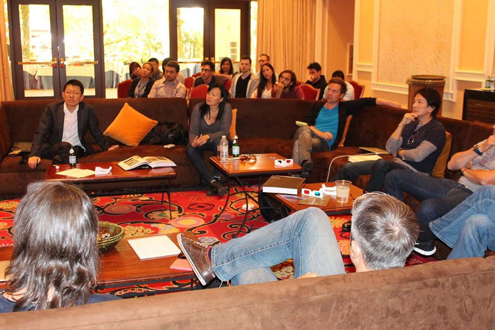 The TV/Cinema/Online Film jury enjoying discussions, while young creatives sit in