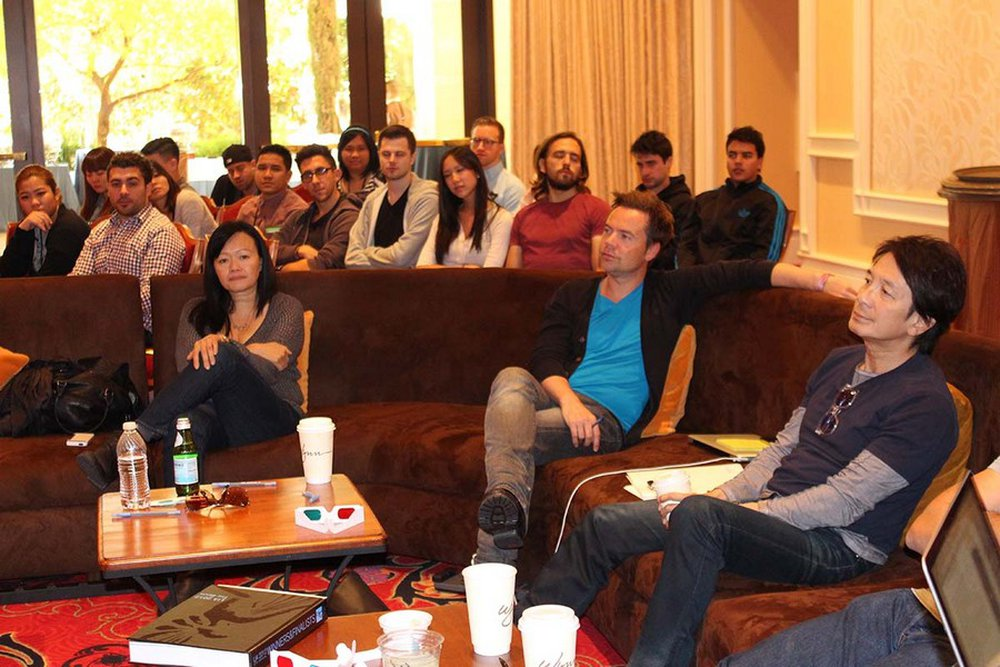 Judy John, Geoffrey Hantson, and Tham Khai Meng in the judging room with young creatives sitting in on discussions