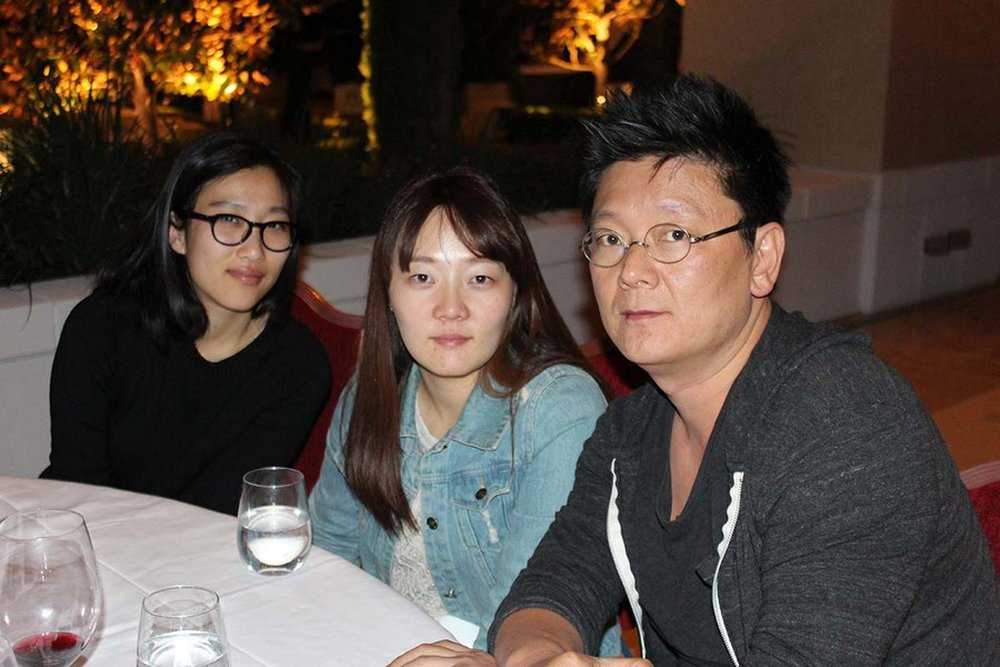 Jeongsil Lee and Ji Min Yoo having a great time with Steve Keum at the patio party