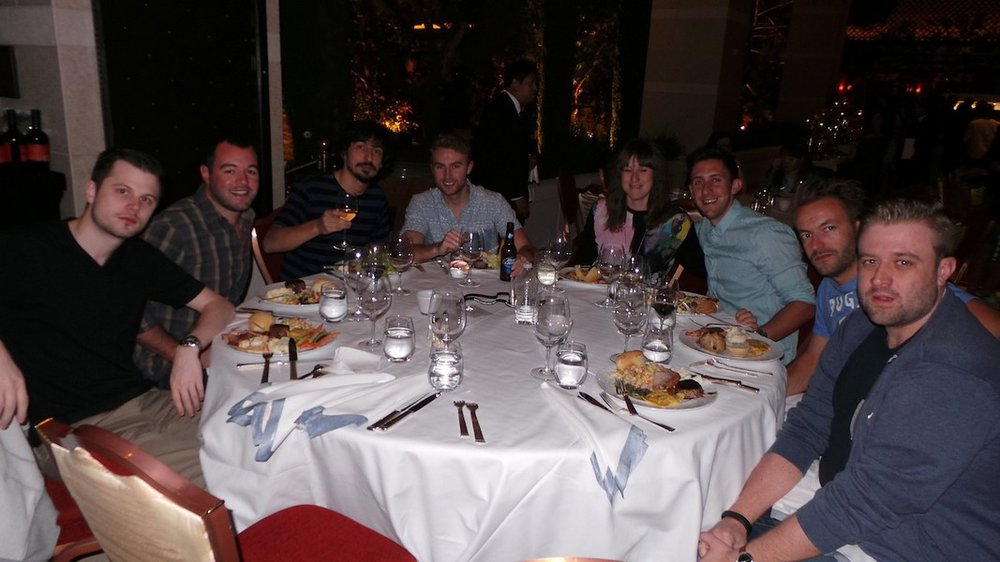 Karol van Bellington, Christopher Mendez, Fernando Calvache, Michael Hughes, Johanna Cresswell, Oliver Rimoldi, Bart Mol, and Graeme Clarke enjoying dinner at the patio party