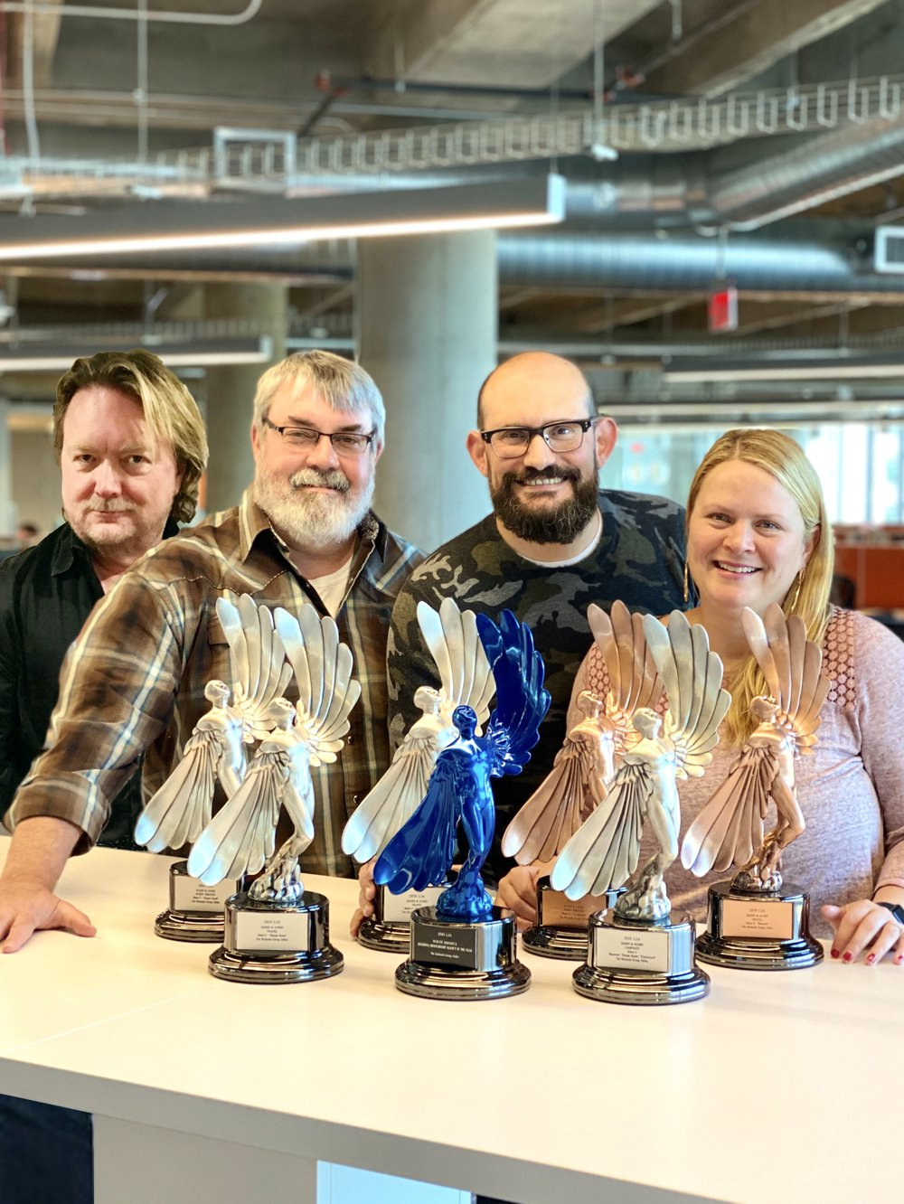 The Richards Group proudly display their Statues, pictured Wendy Mayes, Chris Smith, Bo McCord, and Stuart Hill